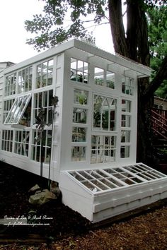 Building a Repurposed Windows Greenhouse ~ you can make a greenhouse inexpensively using old windows! #conservatorygreenhouse #gardening