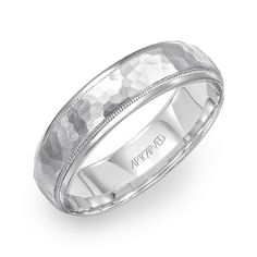 ArtCarved. A wedding band with a rugged look.  www.gembycarati.com  www.facebook.com/gembycarati
