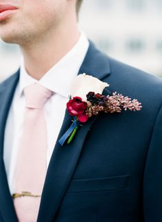 Pink, red and berry boutonniere: http://www.stylemepretty.com/minnesota-weddings/minneapolis/2017/01/25/a-tale-of-love-and-the-most-stunning-backless-dress/ Photography: Amanda Nippoldt - http://www.amandanippoldt.com/