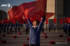 A propaganda troupe perform before the Arch of Triumph on the last day of the 200-day campaign in Pyongyang on December 15, 2016. North Korea wrapped up a 200-day mass mobilisation campaign aimed at boosting an economy struggling with upgraded UN...