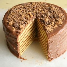 Smith Island Cake   This impressive, many-layered cake is actually a dressed-up Duncan Hines box cake with ground Reese's Peanut Butter Cups sprinkled between every layer.