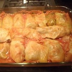 Cabbage Rolls Recipe - Savoy cabbage leaves are stuffed with ground beef, ground sausage and rice in this traditional dish.