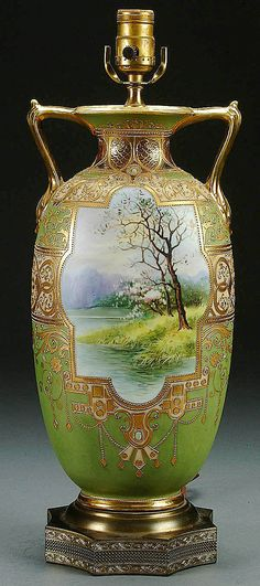 A NIPPON SCENIC DECORATED PORCELAIN VASE/LAMP CIRCA 1910 WITH HAND PAINTED PASTORAL SCENE AND GILT SCROLLING, LATER LAMP MOUNTS