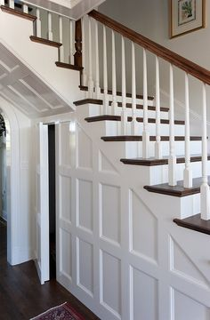 under the stairs. I like how it's almost like a secret door.it just blends in with the wall detail. Traditional Entry Design, Pictures, Remodel, Decor and Ideas - page 102 Closet Under Stairs, Under Stairs Cupboard, Bathroom Under Stairs, Stairway Storage, Storage Stairs, Attic Storage, Office Storage, Closet Storage, Stair Paneling