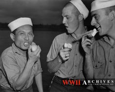 The USS Wahoo (SS-238) at Pearl Harbor, after a patrol during which she sank a Japanese destroyer and an entire convoy of four ships.  Three members of the crew eating apples and ice cream.
