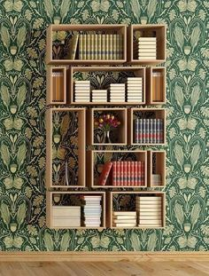 love the wallpaper and the bookshelves.