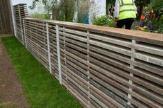 Fence from recycled scaffolding boards
