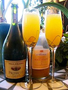 Bellini ~ peach nectar and prosecco.  Garnish with a slice of fresh peach.  (Prosecco is is an Italian sparkling wine, generally a Dry or Extra Dry, and also the name of the white grape that is used to produce it.  Look for Ceres brand juice/nectar)