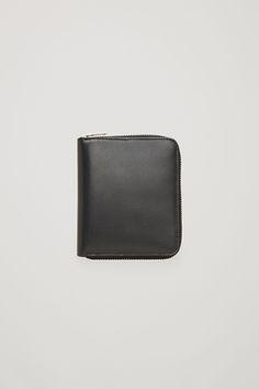 COS image 1 of Leather zip wallet in Black