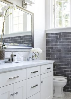 love the vanity/counter, the gray subway on one wall, and the windows - Click image to find more Home Decor Pinterest pins