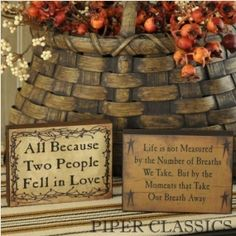 """All Because Two People Mini Sign features a berry vine encircling stenciled letters on distressed ivory painted wood; sign measures just 4"""" long x 3"""" high x 3/4"""" deep. Use on a shelf, table or anywhere. """"All Because Two People Fell in Love""""."""