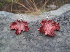 Red Leather Maple Leaf Earrings by MythicalDesigns on Etsy, $16.00. Cute for fall.