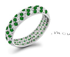 found it....diamond and emerald pave set eternity band. Will be a late 'push present'- both babies birthstones. Want it thicker though...
