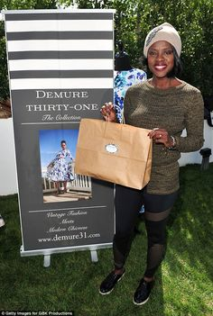 It's in the bag! Viola Davis, 51, posed at a Beverly Hills gifting suite Saturday, a day b...