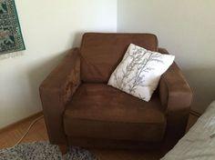 Ruskea Furninova-nojatuoli