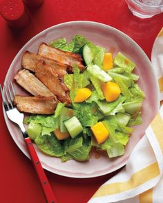 Slices of pan-cooked boneless pork loin chops complement a refreshing combination of mango and cucumber. The salad is accented with a spicy-sweet dressing of lime juice, honey, and chili powder. Feel free to use boneless chicken breasts or turkey cutlets in place of the pork.