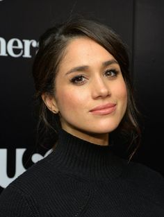 At an event in 2012, Meghan sported a loose chignon and black turtleneck that left her looking like a dead ...