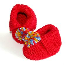 These bright and fun booties are very soft and knitted with care and love. To keep those little toes warm indoors and out. Knitted in cotton they are cool