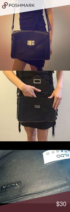 ALDO BLACK CROSS BODY CLUTCH really sleek Aldo clutch crossbody purse. black and silver. zipper siding. a twist closure. there is a removable strap so u can also carry as a clutch bag. great condition. Aldo Bags Crossbody Bags