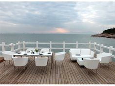 A dining table, eight chairs, a two seater sofa and a coffee table - Sao Paulo Collection by Sérénité Luxury Outdoor