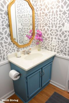 DIY Home Decorating Project - Small Gray Modern Bathroom Makeover by Thrift Diving using the Mansion House Grille Wall Stencils from Royal Design Studio Half Bathroom Decor, Bathroom Red, Budget Bathroom, Bathroom Styling, Bathroom Makeovers, Bathroom Cabinets, Half Bathroom With Wallpaper, Wallpaper For Powder Room, Bathroom Wallpaper Inspiration