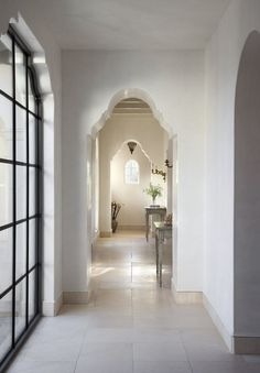 Venetian plaster walls, casement fenestration, stone floors,and precise arches