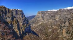 The Vikos Gorge is a gorge in the Pindus Mountains of northern Greece. It lies on the southern slopes of Mount Tymfi, with a length of about 20 km, depth ranging from 120 to 490 m and a width ranging from 400 m only a few metres at its narrowest part.