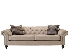 A pleasing mix of relaxed and refined, this Harlow chenille sofa will add distinction to your living space. The rolled arms and back are enhanced with sophisticated button tufting and nailhead trim. Neutral silver chenille combines an upscale look and feel with family-friendly durability and can be paired with rich colors or other gray tones and neutrals for design versatility. Decorative turned feet and accent pillows complete the look.