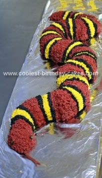 Homemade King Snake Cake: This King Snake cake was made from 2 bundt cakes. Each cake was cut in 1/2 and place end to end to form the snake. A serrated knife was used to carve away