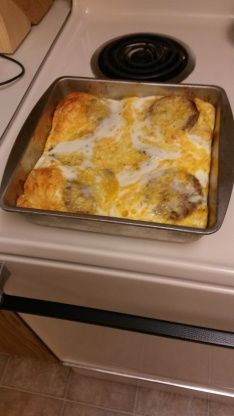 Line your pan with canned refrigerated biscuits and add topping of sausage and cheese; pour on egg mixture and bake.  Simple and so delicious!