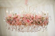a gorgeous chandelier adorned with roses...love it!