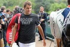 Roger Federer arrives for his first round map at Wimbledon 2013.