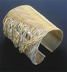 Cuff | Barbara Patrick.  Sterling silver and coloured golds (18kt & 22kt yellow, read and green)