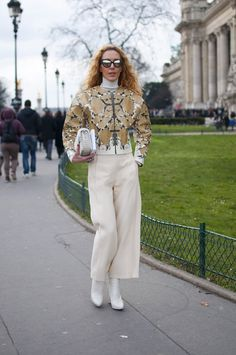 Elina Halimi in snakeskin jacket and wide legged pants after Chanel