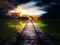 railroad tracks; i walk this path alone traveled by hundreds before me