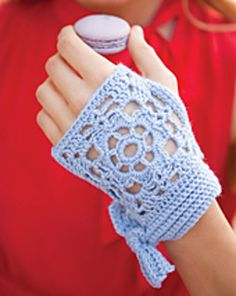 Keep sweets within reach wearing a pair of fingerless mitts with petite bows.