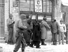 "General Troy H. Middleton, CO VIII Corps  shakes the hand of General Maxwell D. Taylor CO 101st Division in Bastogne on January 18, 1945. They are in front of ""The Bastion of the Battered Bastards of the 101st"" sign. Military Men, Military History, 101st Airborne Division, Ardennes, Band Of Brothers, National Archives, American Soldiers, World War Two, Belgium"