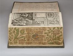 The Holy Bible; Bound in blue velvet, embroidered with coloured silks, silver and silver-gilt wire; fore-edge painting of royal arms; Created: John Field for John Ogilby (Cambridge printer); Creation Date: 1660; Acquirer:   King George V, King of the United Kingdom (1865-1936)