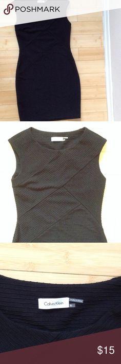 Black Calvin Klein work dress Beautiful criss cross details on this form fitting work dress.  Worn once. Calvin Klein Dresses Midi