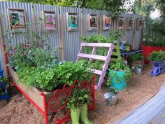 "Love the raised ""bed"" bed, the old ruber boots as planters, and the privacy fence materials.  The colors are vibrant and fun too.  Google Image Result for http://youreasygarden.com/sites/default/files/IMG_0844%2520(1).jpg"