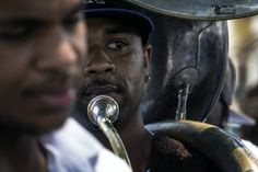 Young Men Olympian Jr. Benevolent Association, second line parade in Central City.