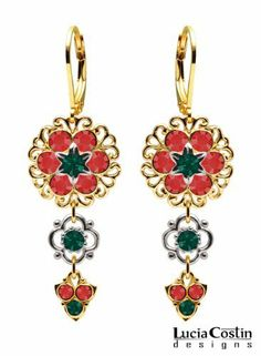 .925 Sterling Silver with 14K Yellow Gold Plating Dangle Earrings by Lucia Costin with Sterling Silver 4 Petal Flowers, Filigree Ornaments, Red and Emerald Green Swarovski Crystals, Adorned with Lovely Charms; Handmade in USA Lucia Costin. $63.00. Unique jewelry handmade in USA. Update your everyday style with inspiration when wearing this piece of jewelry. Garnished with red and emerald green Swarovski crystals. Dangle earrings beautifully designed by Lucia Costin...