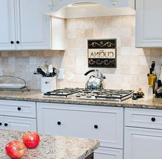 white cabinets and Venetian ice countertops