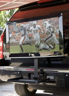 Tv holder that hooks onto your hitch, perfect when you want to tailgate but dont have tickets to the game!  #UltimateTailgate #Fanatics