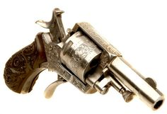 Bulldog revolver Manufactured in Great Britain around the 1880-90′s. .320 Bulldog six-round cylinder, double action with folding trigger, side loading gate and pivoting ejector rod, nickel finish, extensively engraved. It's like the last tier of bulldog revolvers in a Call of Juarez game.