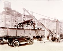 Workmen loading automobiles onto a freight car in Paterson, New Jersey