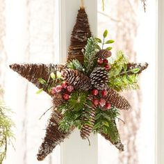 Handcrafted of natural twigs and pinecones, our star wreath suggests you spent hours foraging in the woods for the perfect rustic materials. Your secret's safe with us. The realistic snow, greenery and holly berries add even more character to your holiday decor. Tip: Hang three in a row over a picture window or above your foyer console.