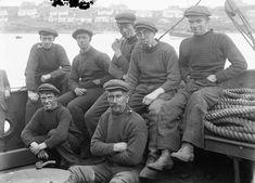 Fishermen on board the coal boat Hamnavoe