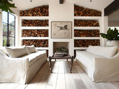 Beautiful and simple way to store firewood. And that whitewashed floor, fabulous.