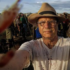 photo by @randyolson   words by @neilshea13  Randy Olson soaked in blood. One of my favorite images because it shows what hell do how far hell go. Wed crashed a party a celebration of the Daasanach tribe and he was in close photographing the ritual slaughter of a bull that would feed many families. Warriors had speared the beast and its blood pooled on the ground mixing there with mud and dung. All around men and women were singing and dancing hoisting spears shaking stone-filled gourds and…
